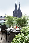 Terrace with view to Cologne Cathedral | Lindner Hotel Dom Residence - Koeln