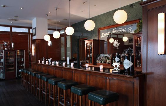 Reserve a table and take a seat in the original Harrys New York Bar Frankfurt