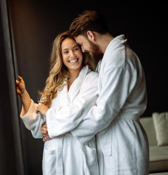 couple, relaxation, people, wellness, caucasian, love, spa, bathrobe, man, young, hotel, honeymoon, robe, romantic, vacation, weekend, happiness, holidays, resort, smile, lifestyle, married, looking, travel, standing, scene, adult, together, indoors, togetherness, bath, holiday, luxury, relax, tourist, white, woman, portrait, well, women, affectionate, embracing, two, positivity, relationship, morning, male, relaxing